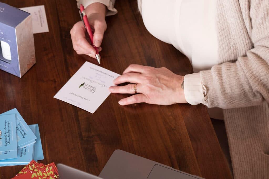 Woman writing Rimita Green thank you card